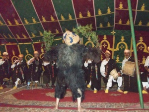 BOUJELOUD: The person taking on the role of Boujeloud wears a straw hat and is dressed in an outfit made of goat-skins.