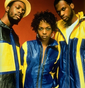 Lauryn with her fellow Fugees, Wyclef Jean (left), and Pras Michel (right) in 1996.