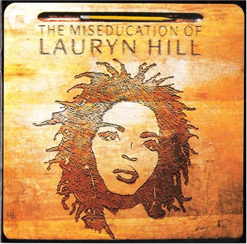 A bird's-eye view of a school-desk forms the basis of Lauryn's 'Miseducation' album-cover.