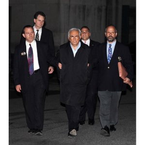 Strauss-Kahn walking out of a New York police station in cuffs in 2011 after being arrested for allegedly sexually  attacking a hotel maid.