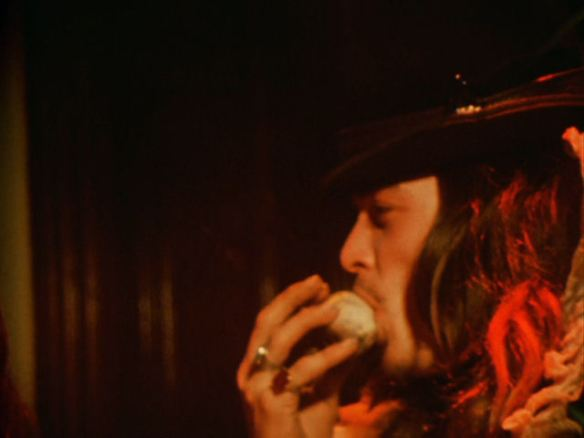"Kenneth Anger:  ""That's Bobby Beusoleil sucking on a skull. That's a reefer posed in a skull which is a kind of exotic way of smoking."""