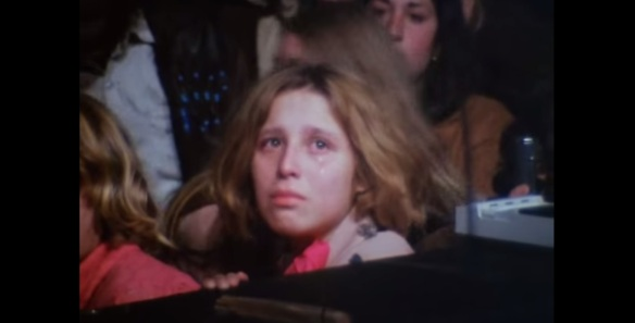 'BAD VIBES'... The documentary-cameras focus on a tear-stained member of the audience at the front of the stage.