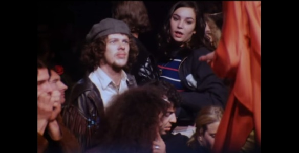 LOOK OF DISAPPROVAL?... Crowd-member stares up at Jagger.