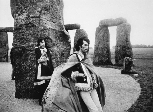 Mick Jagger and Keith Richards at Stonehenge, 1967. Photographed by Michael Cooper.