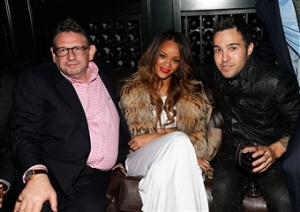 Lucian Grainge (left) with Rihanna at the Grammy's after-party, 2013.